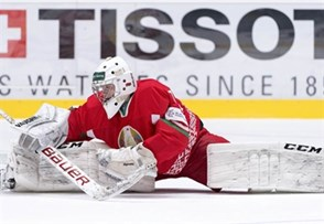 SPISSKA NOVA VES, SLOVAKIA - APRIL 13: Belarus' Andrei Grishenko #1 stretches during warm-up prior to preliminary round action against the U.S. at the 2017 IIHF Ice Hockey U18 World Championship. (Photo by Steve Kingsman/HHOF-IIHF Images)