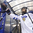 POPRAD, SLOVAKIA - APRIL 16: Finland's Aarre Isiguzo #6 high fives a fan while walking to the ice prior to preliminary round action against Latvia at the 2017 IIHF Ice Hockey U18 World Championship. (Photo by Andrea Cardin/HHOF-IIHF Images)