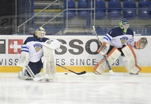 POPRAD, SLOVAKIA - APRIL 18: Finland's Ukko-Pekka Luukkonen #1 and Lassi Lehtinen #30 warm up prior to preliminary round action against Canada at the 2017 IIHF Ice Hockey U18 World Championship. (Photo by Andrea Cardin/HHOF-IIHF Images)