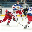 SPISSKA NOVA VES, SLOVAKIA - APRIL 18: The Czech Republic's Jan Hladonik #13 lets a shot go while Russia's Semyon Perelyayev #20 defends during preliminary round action at the 2017 IIHF Ice Hockey U18 World Championship. (Photo by Steve Kingsman/HHOF-IIHF Images)