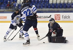 POPRAD, SLOVAKIA - APRIL 23: USA's Dylan St. Cyr #1 makes a save while Finland's Jesse Ylonen #29 and Santeri Virtanen #22 look on during gold medal game action at the 2017 IIHF Ice Hockey U18 World Championship. (Photo by Andrea Cardin/HHOF-IIHF Images)